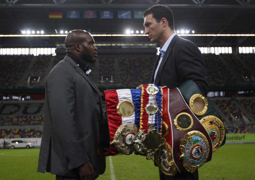 Heavyweight boxing title holder Klitschko of Ukraine and Mormeck of France pose during a news conference in Duesseldorf